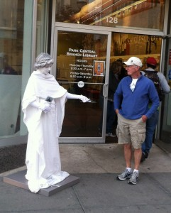 "Our ""living statue"" distributes promotional flyers in the run-up to the game."